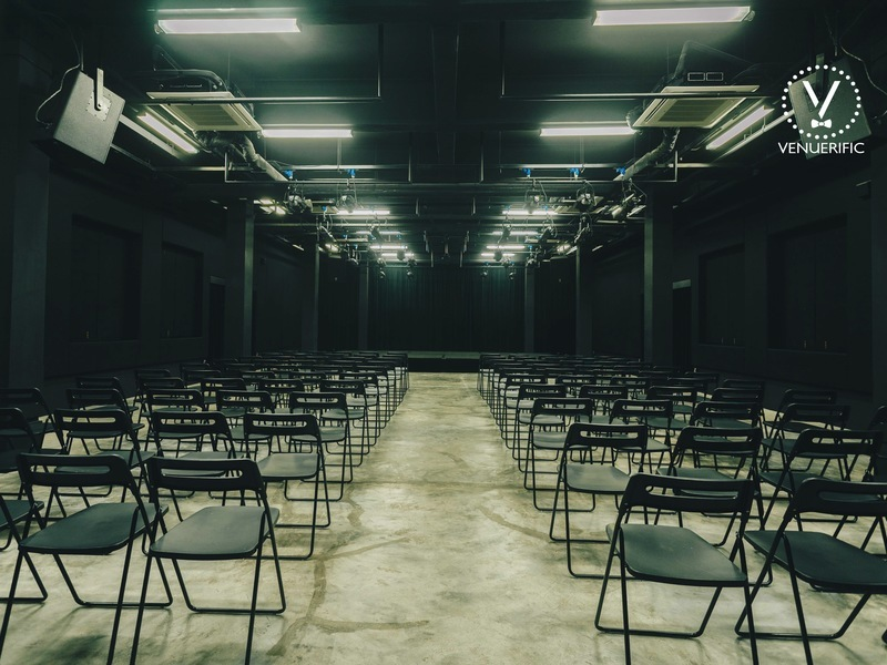 Huge room with foldable chairs and stage