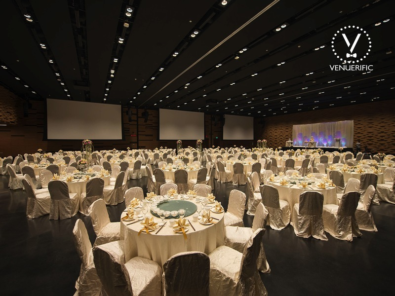 spacious grand ballroom with round table setting
