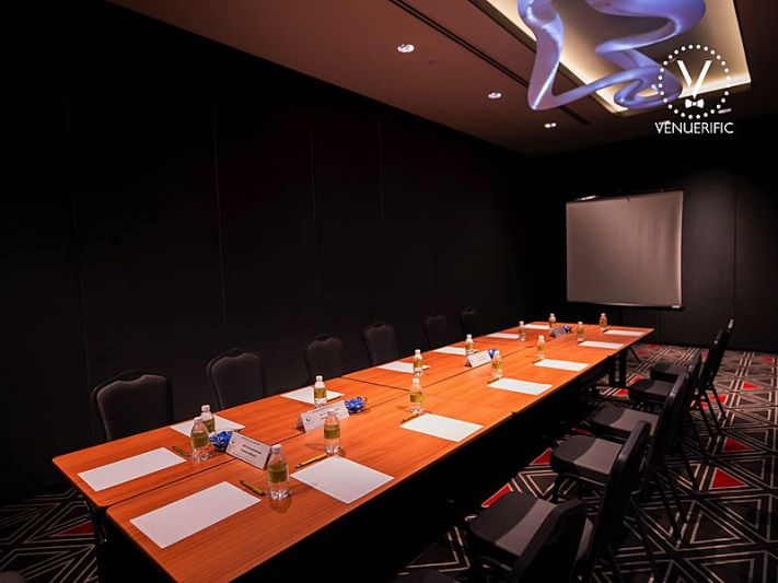 Small meeting room with screen projector