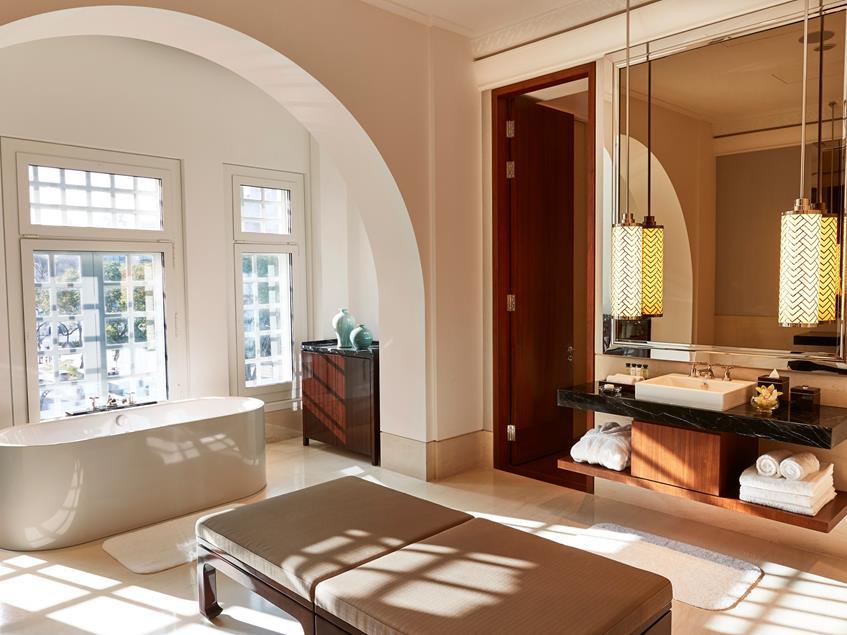 Elegant bedroom hotel at The Capitol Kempinski Hotel Singapore