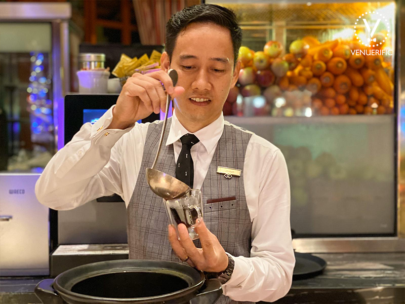 male bartender pour german wine to the glass