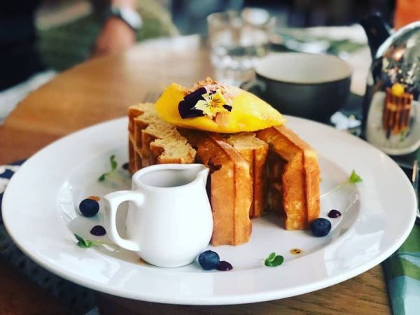 belgian waffle served with blueberry sauce