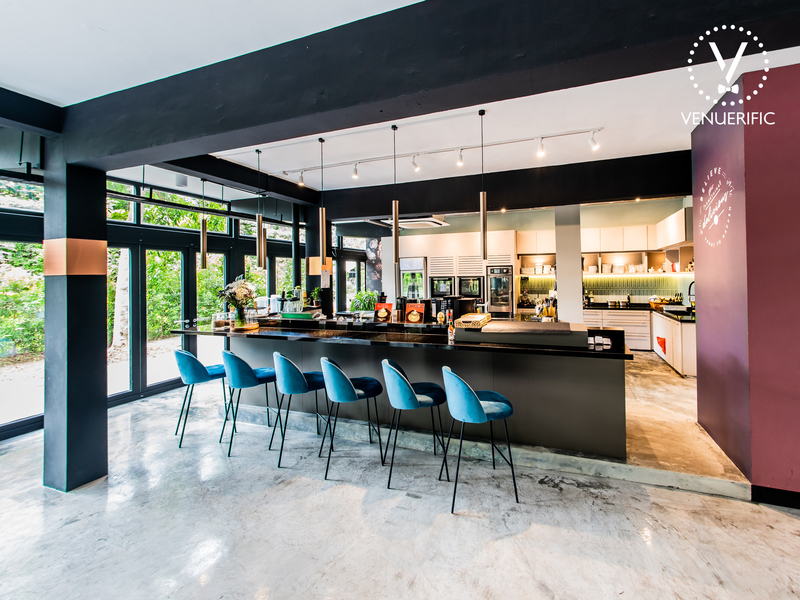 singapore mini bar with blue chairs and black-white interior