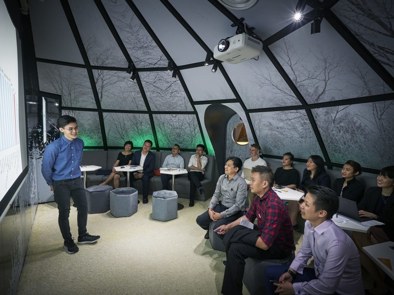igloo room theme with screen projector during training session