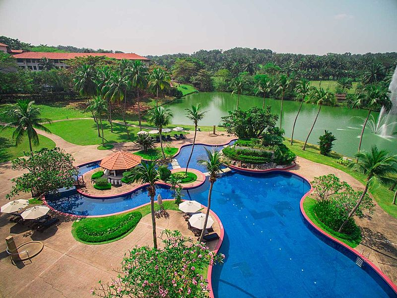 resort destination in the kuala lumpur city with a lake and lush greenery