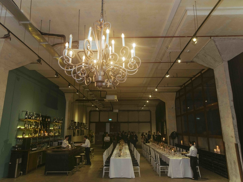 private dining venue in singapore with long white tables and pendant lamps