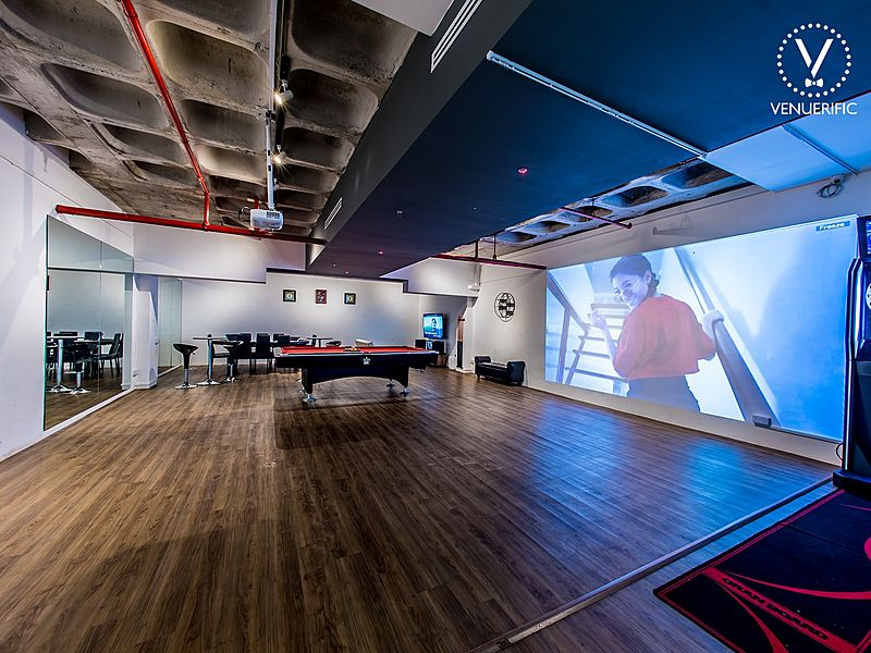wide space with poker table, big projector and karaoke machines