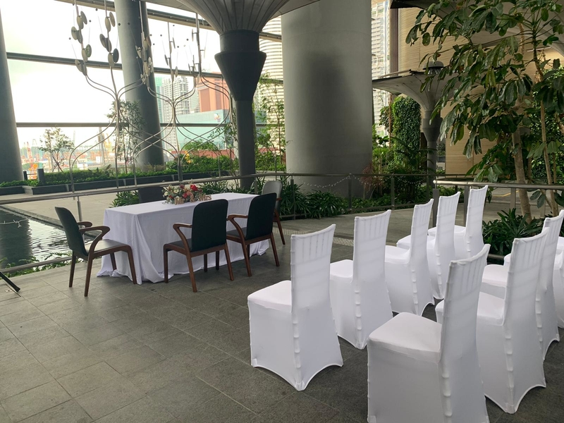 semi outdoor solemnisation event space in singapore with white seating