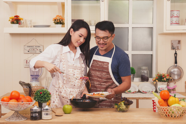 happy couple is cooking together for their ndp celebration