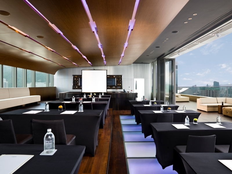 corporate training setup using projector screen with a view of hong kong harbour