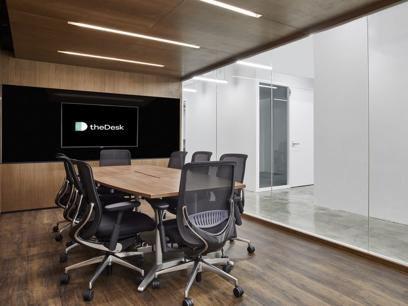 meeting room with conference style setup and floor to ceiling glass window