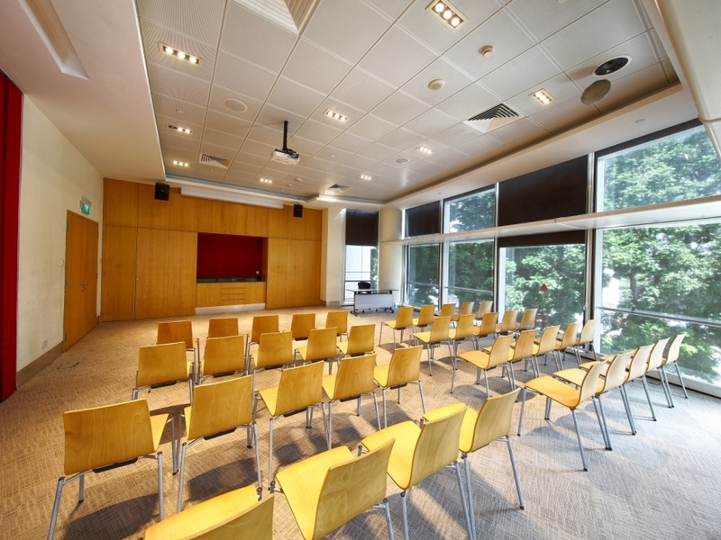 garden view conference room in singapore with yellow audience chairs