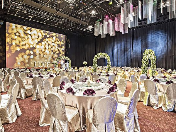 hotel grand ballroom with round table seating style for wedding reception
