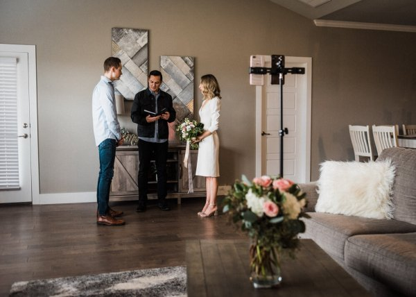 couples are doing their virtual wedding solemnisation at their living room