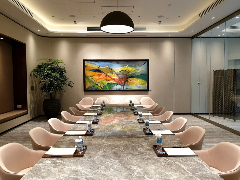 singapore glass wall meeting room with long table and refreshments