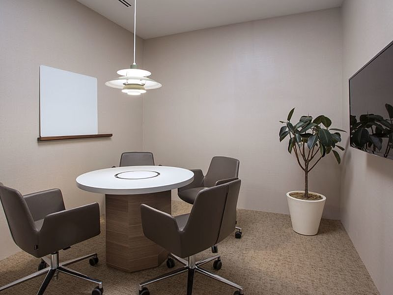 small meeting room in singapore with round table and white board