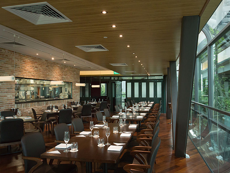 fine dining restaurant in central singapore with long table and large glass