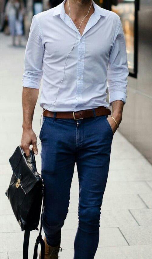 man in light blue shirt and dark pants