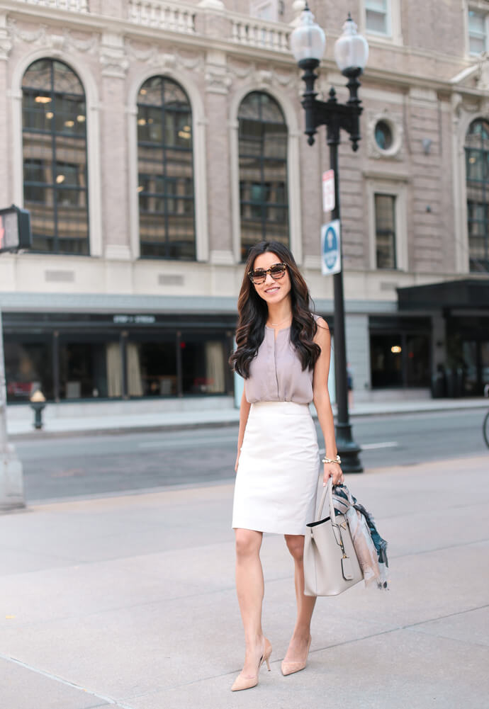 lady in light blouse and white pencil skirt