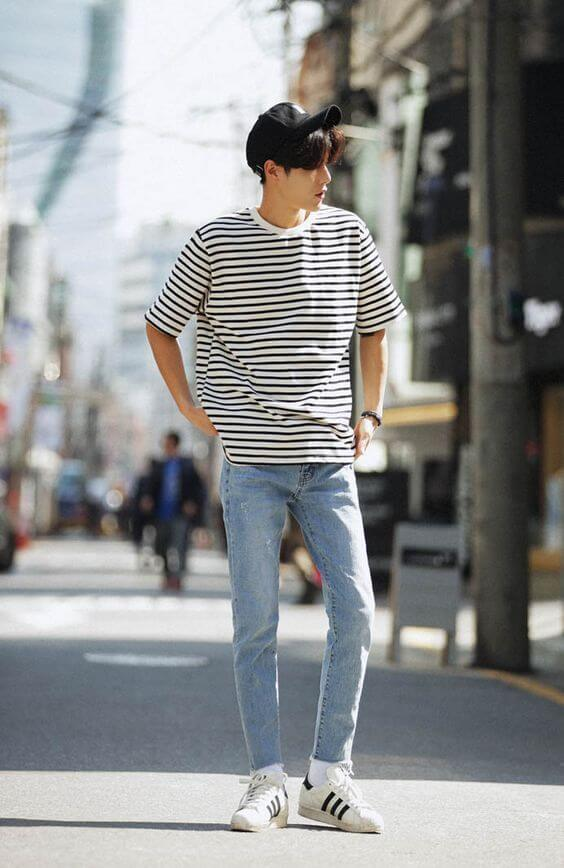 guy in striped shirt and blue pants