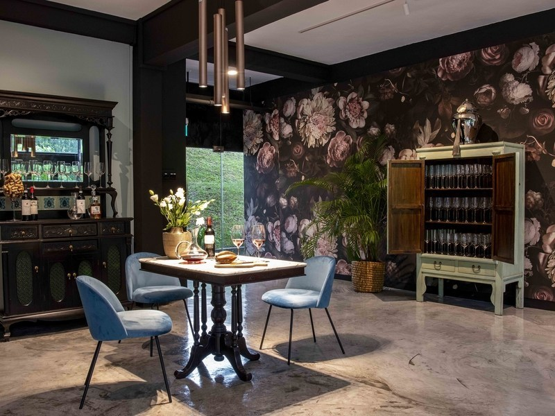 private dining space in singapore with blue chairs and flowers decorations