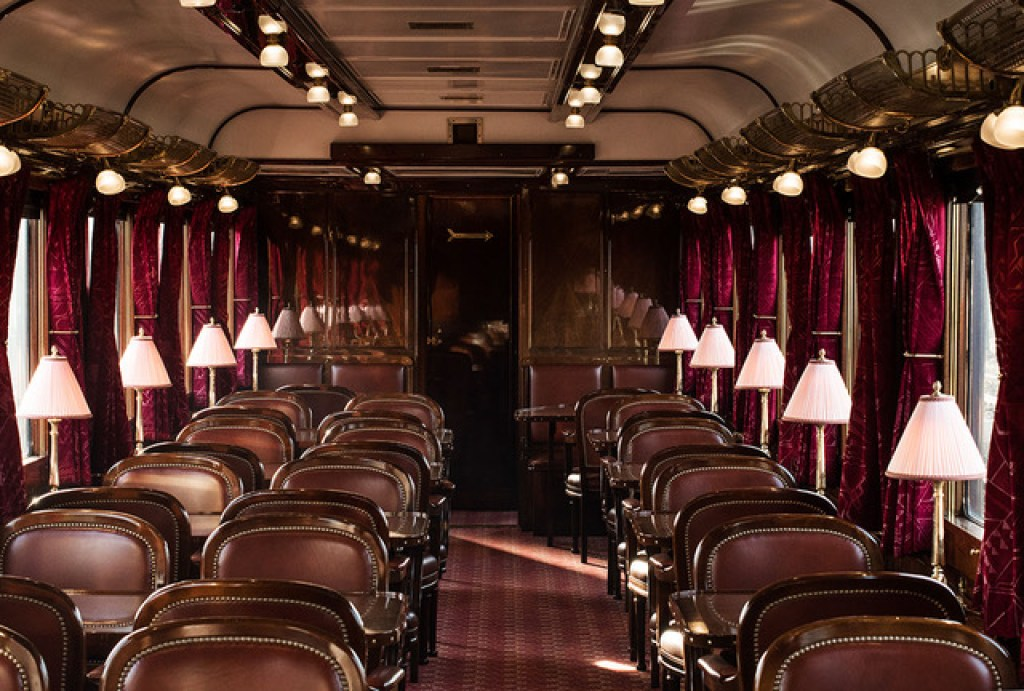 orient express train's interior with maroon colours and dining table
