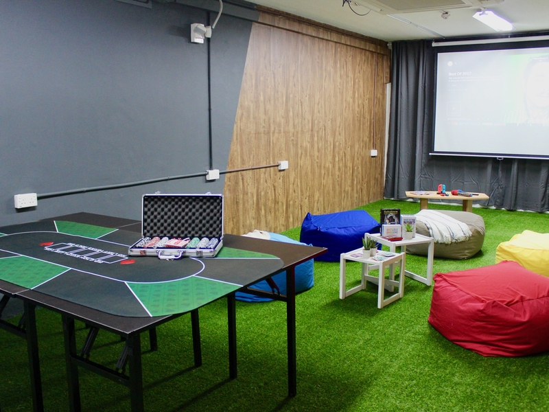Projector with bean bags and poker table
