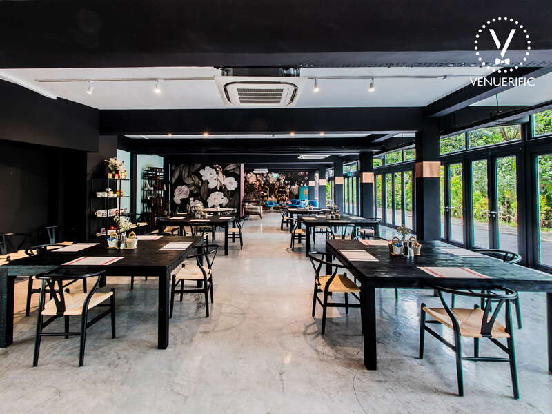 black theme of main dining area with floor to ceiling window