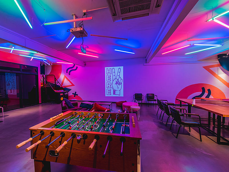 party event space with mood lighting and projectors