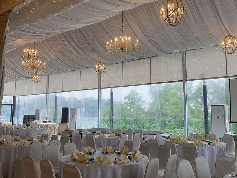 wedding tables under a white tent