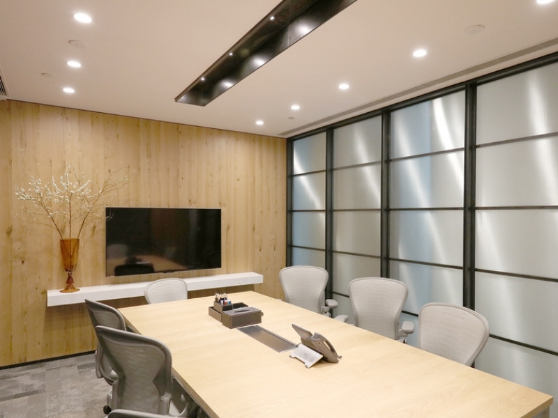 Brightly lit executive meeting room with movable chairs