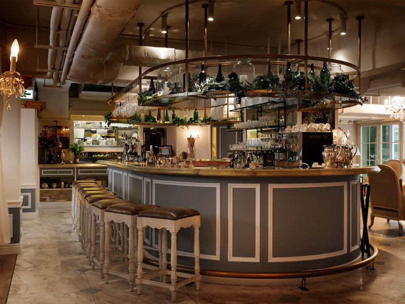 bar seating area decorated with plants