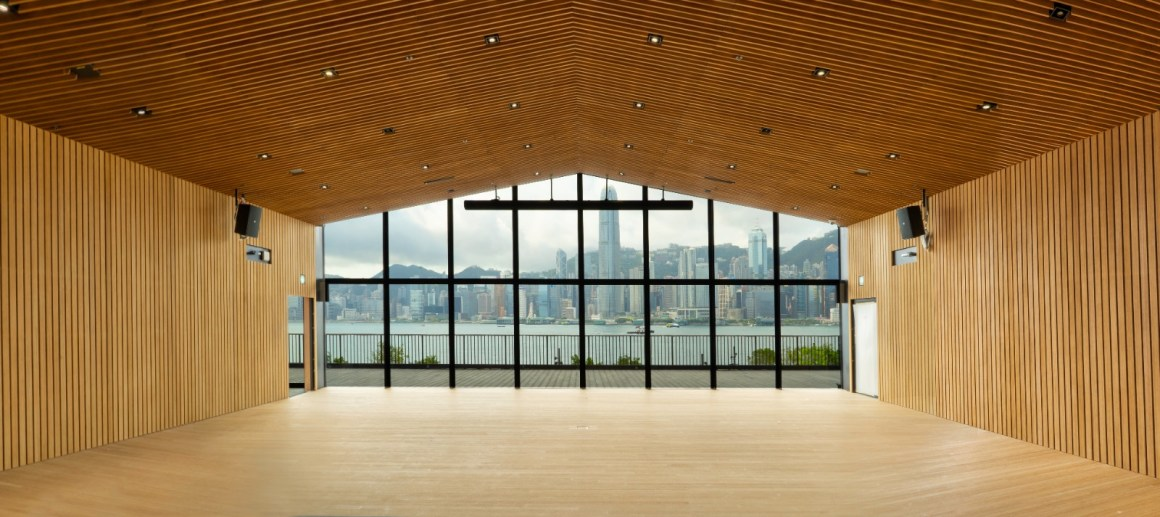 Indoor room with extensive wood work and a view of Hong Kong Harbour