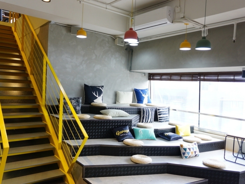 colourful cushion in a resting area beside yellow stairs