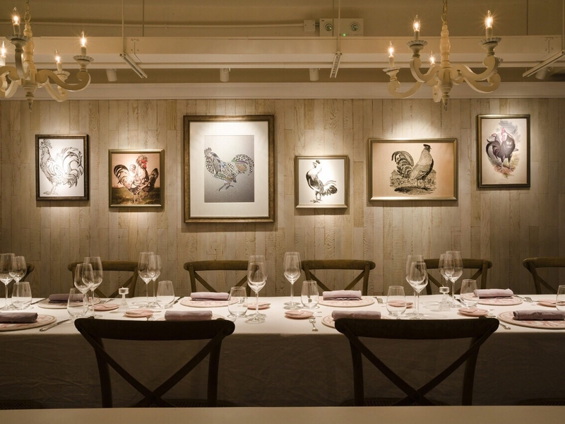 restaurant interior with pictures and chandelier