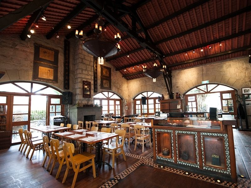 Cosy brick wall interior dining hall with chairs and tables