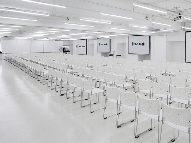 many white chairs lined up in a meeting room