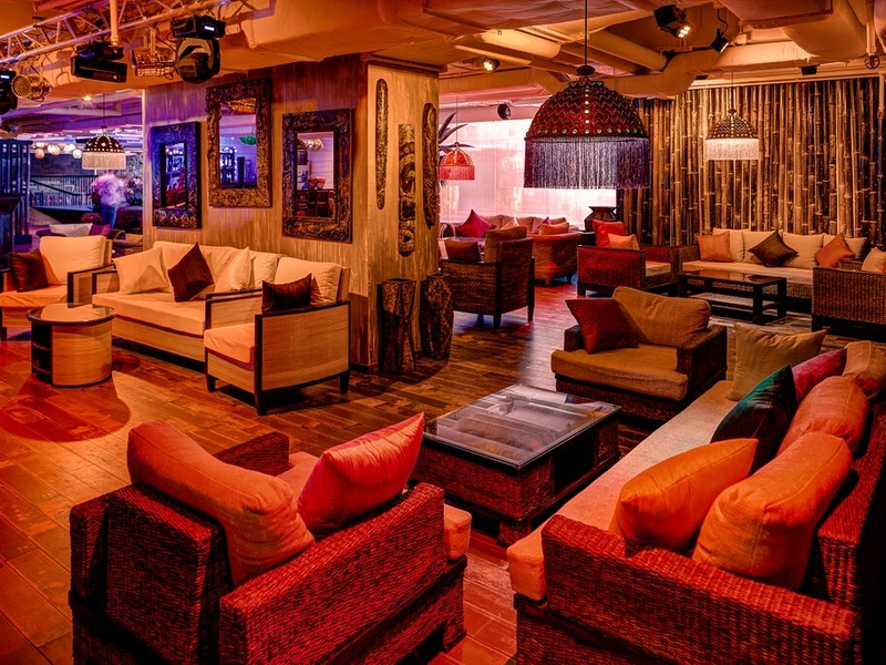multiple sofas in an island themed room