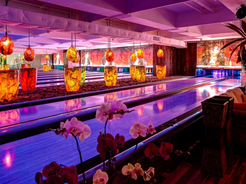 bowling alley with flowers and neon lights