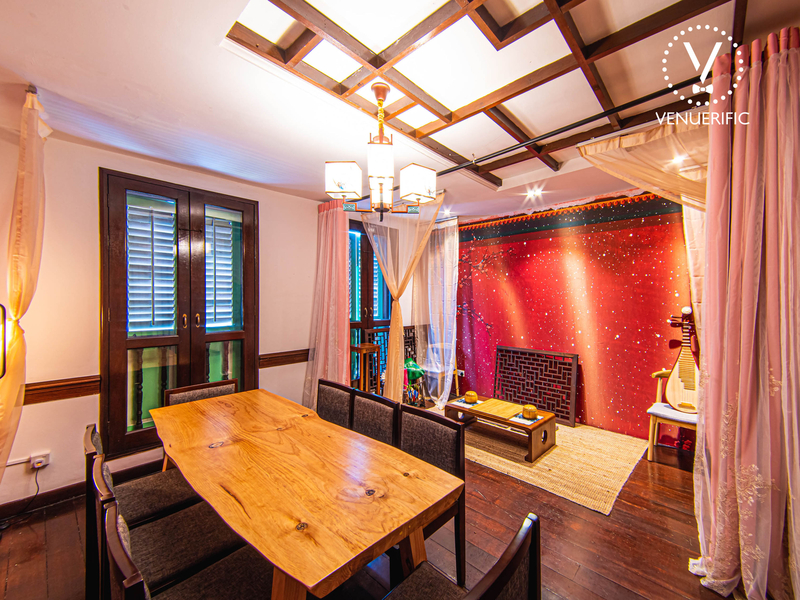 Lounge area with tables and chairs, and a traditional Chinese tea room