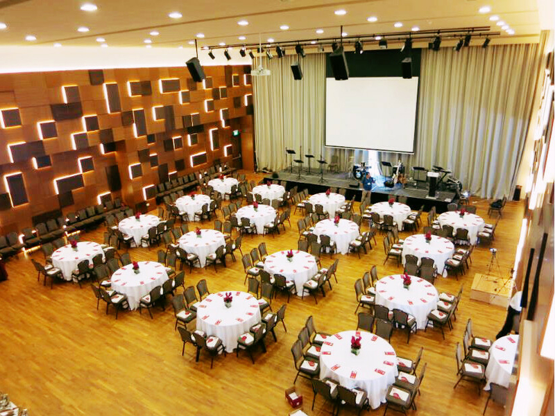 big hall with circular tables and chairs