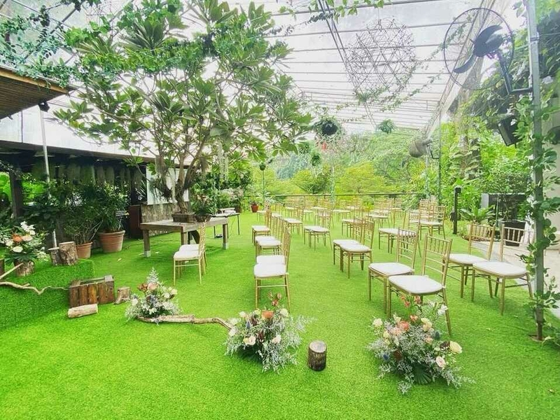 Green outdoor event area with chair set up