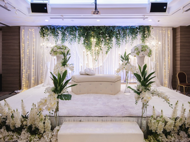 white floral set up on a stage