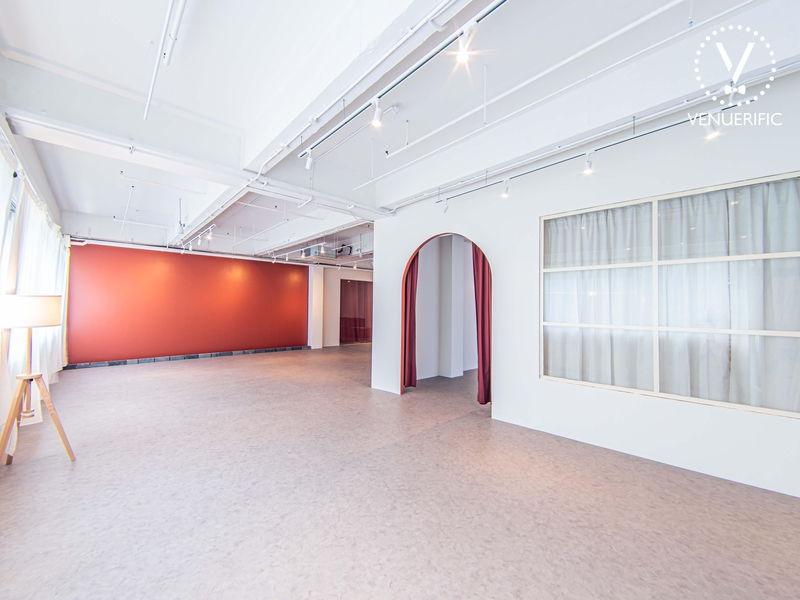 spacious space with red painted walls