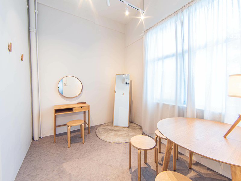 room with wooden chairs and tables