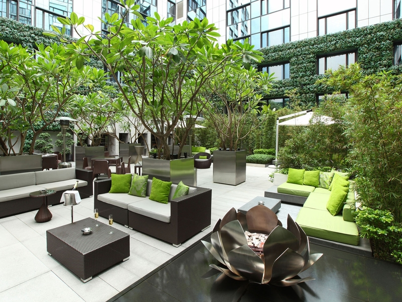 cosy outdoor seating area in a building with nature