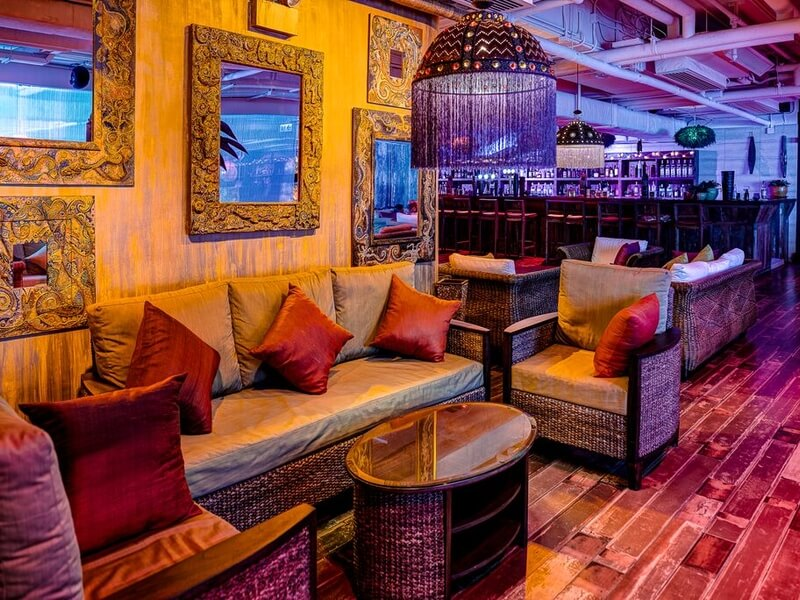 unique space with sofas near a bar and colourful lights