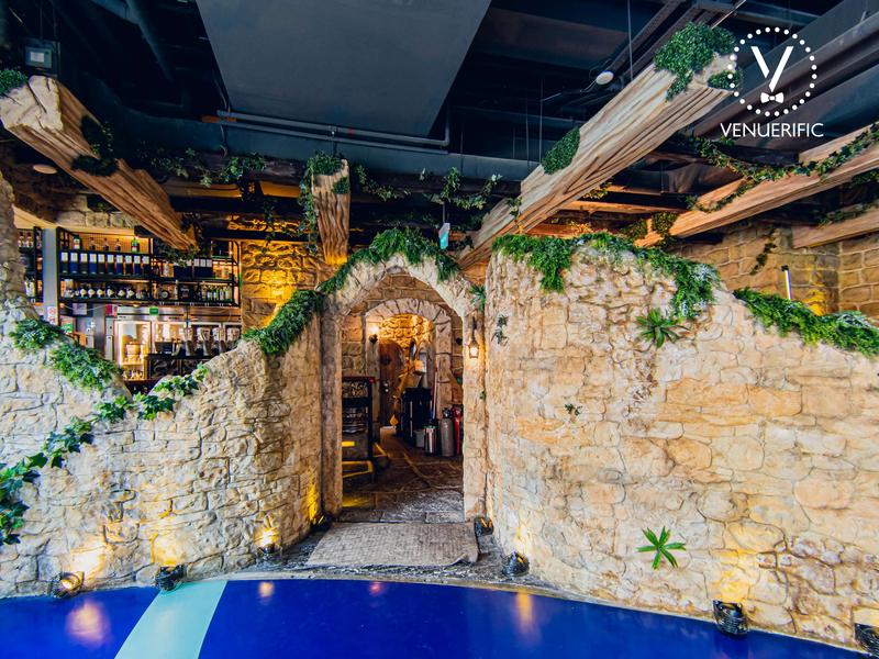 stone wall entrance into a restaurant