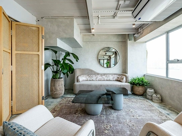 Indoor sitting area with sofas and plants
