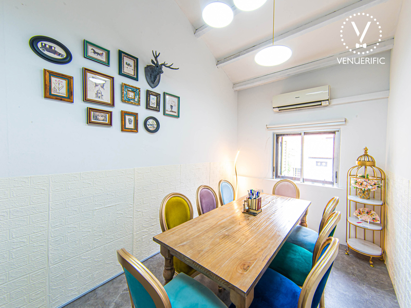 Colourful themed chairs in a white meeting room with Alice In Wonderland style decor.